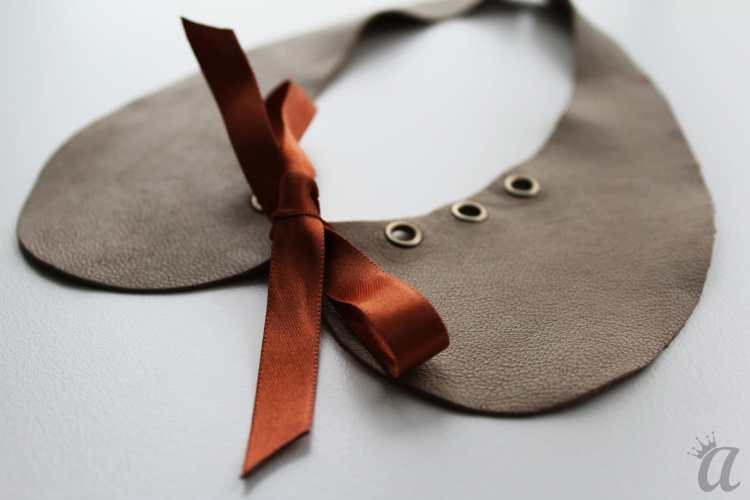 gray leather necklace with brown bow (detail)
