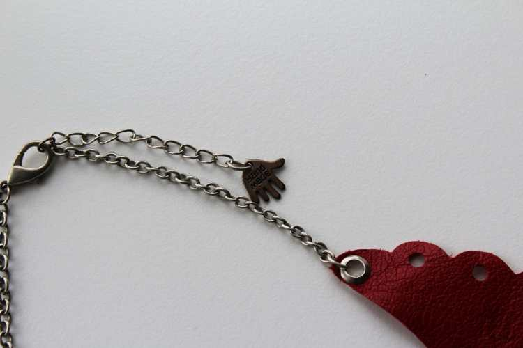 perforated red leather necklace (detail)
